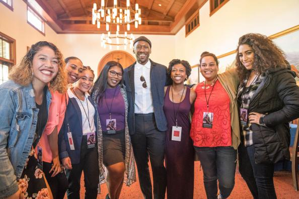 Mahershala Ali '96 poses with HP students