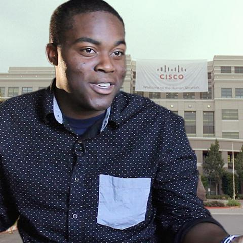 Jalen O'Neal-Strawder '19 smiles in front of the Cisco building