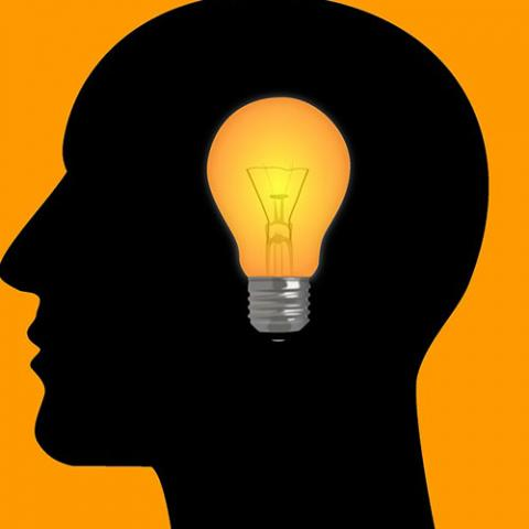 An illustration of a person with a light bulb