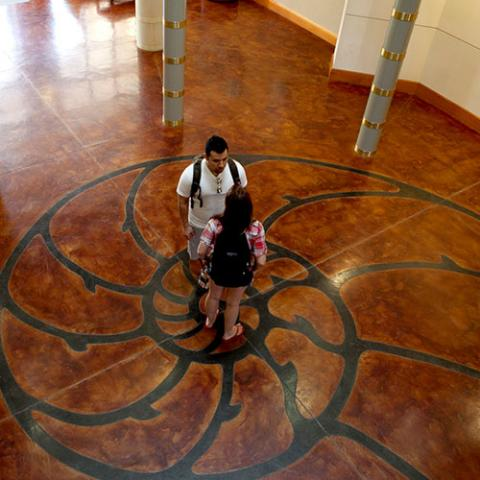 Students stand in the middle of the science building on campus.