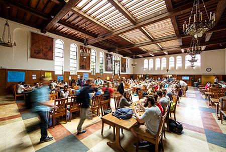Students eat in Oliver Hall on campus.